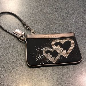 Black and silver Coach poppy wristlet with hearts